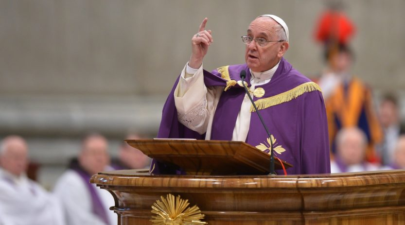 Pope Francis speaks during a penitential ceremony on March 13, 2015 at St Peter's basilica in Vatican. Pope Francis declared an extraordinary jubilee year to celebrate the 50th anniversary of a landmark Vatican council and said the Church was bound to continue its  reforming work. The year will be dedicated to the theme of mercy and begin on December 8th, the date the Vatican II council closed in 1965, Francis said in St Peter's cathedral on the second anniversary of his election as pope.  AFP PHOTO / ALBERTO PIZZOLI        (Photo credit should read ALBERTO PIZZOLI/AFP/Getty Images)
